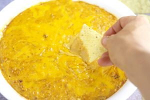Super Easy Chili Cheese Dip Recipe- a crowd-pleasing, low-maintenance dip recipe and appetizer with gooey cheese and chili. Great for parties! This is one of my faves!