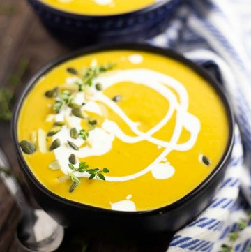 Butternut Squash Bisque is a rich, but healthy vegetarian fall soup with roasted butternut squash that is sweet and creamy with just a touch of heat. Butternut squash soup with apples for sweetness, jalapenos for a spicy kick, and a little cream to up the creaminess. Also has vegan instructions!