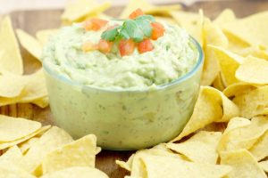 Creamy Guacamole - The perfect dip recipe for chips! Easy guacamole with extra creaminess. Great for a party or football games!