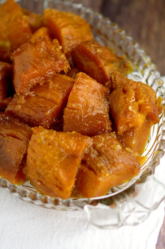 Classic Candied Sweet Potatoes baked in butter and sweet brown sugar are a sweet and delightful side dishes recipe for your Thanksgiving table. Plus they're super simple and easy to make. I LOVE these! They're my favorite part of Thanksgiving!