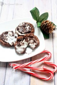 These Peppermint Fudge Cookies are a chocolate fudge-y dream, topped with a peppermint patty for a little Christmas festiveness. From TheGraciousWife.com #Christmas #cookies