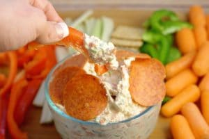 Italian Veggie Dip Recipe - an easy cold dip recipe with cream cheese.  Italian Veggie Dip is a cool, creamy, and fresh Italian veggie dip packed with pepperoni, cheese, and lots of flavor. Serve with an assortment of colorful veggies. This is so amazing with fresh vegetables or crackers! Perfect for a party!