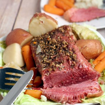 Slow Cooker Corned Beef and Cabbage is the perfect traditional dish to celebrate St Patrick's Day. Fix it and forget it with this easy CrockpotCorned Beef and Cabbage dinner recipe. This is most juicy and delicious!