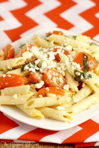 This Easy Feta Pasta Salad Recipe with Italian dressing uses just 5 ingredients and is made in just 30 minutes! A perfect salad side dish recipe idea for a picnic, party, or BBQ all Spring and Summer long.  Creamy feta, juicy tomatoes, and fresh basil make this dish amazing! So easy but oh-so-good.