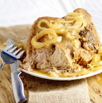 Tender, juicy Crockpot Pork Roast recipe with added zing from soy sauce and red wine vinegar is a perfect low maintenance easy dinner idea for family and company.  Pair it with your classic mashed potatoes and veggies for a cozy meal.