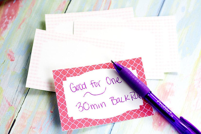 "Blank love coupon with ""Good for one 30 min back rub"" written on it in purple pen"