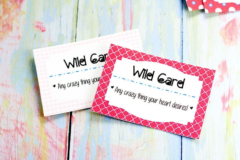 Wild card from love coupon set on pastel rainbow wood background
