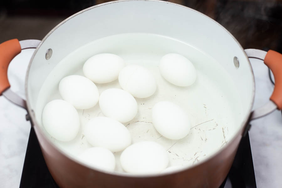 10 eggs in a large pot of water getting ready to be boiled