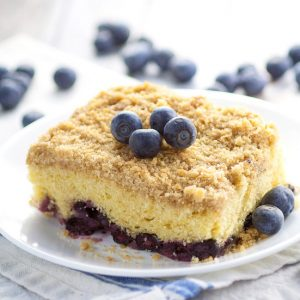 Classic Blueberry Buckle Recipe - Sweet and tangy combine to make this Classic Blueberry Buckle cake recipe truly amazing, with moist cake, fresh blueberries and a crumbly, crunchy streusel topping.  Easy dessert recipe to make and tastes AMAZING with fresh Summer blueberries.