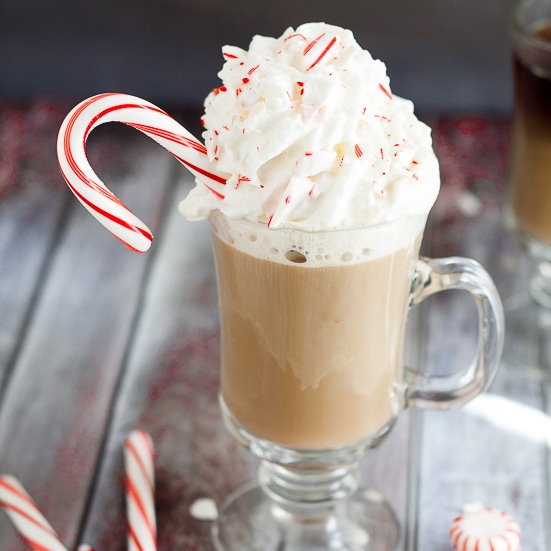 Homemade Peppermint Coffee Creamer Recipe - This Homemade Peppermint Coffee Creamer recipe is a festive way to enjoy your coffee and get more done during the holiday season. Sweet peppermint in hot coffee... Mmmm... Seriously so easy to make.  Peppermint coffee during Christmas is my absolute favorite!
