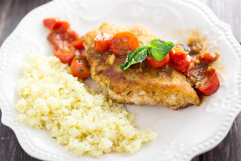 Breaded Chicken with Tomatoes Recipe -Simple but delicious, this Breaded Chicken with Tomatoes recipe has Parmesan Italian breaded chicken breasts with a zesty tomato sauce to make an amazing dinner.