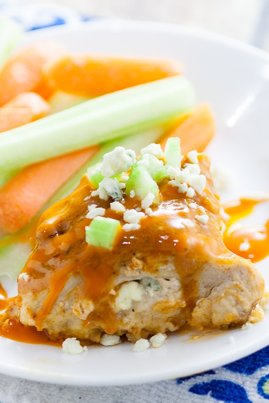 Buffalo Stuffed Chicken Breasts Recipe - Zesty spicy Buffalo Stuffed Chicken Breasts smothered in buffalo sauce and stuffed with creamy blue cheese is an elegant way to enjoy your favorite appetizer for dinner.