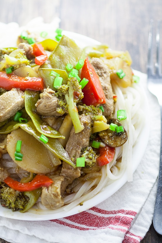 Ginger Pork Stir Fry Recipe - Super easy and healthy too, this Ginger Pork Stir Fry recipe is packed with flavor from teriyaki, ginger, garlic, pork, and more, plus all of your favorite veggies. Perfect quick and easy healthy family dinner recipe!