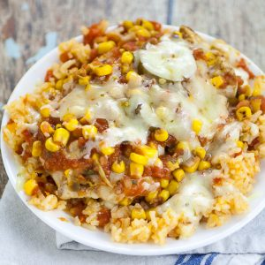 Skillet Southwest Smothered Chicken Recipe - Cheesy and zesty and made in just 30 minutes in one skillet! This Skillet Southwest Smothered Chicken recipe has it all and will be a new family favorite! Quick and easy family dinner recipe