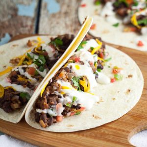 Sriracha Ranch Black Bean Tacos Recipe - Spicy and creamy Sriracha Ranch Black Bean Tacos are way better than your average black bean tacos.  They make a fabulous meatless family dinner.