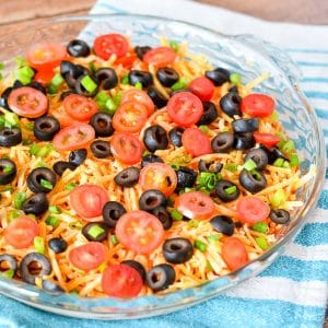 Taco Dip Recipe -Taco Dip is a super quick and easy recipe perfect for game day and parties with classic taco flavors like sour cream, beans, and salsa! Plus, you can customize it to your own tastes!