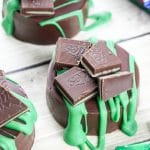 It takes just 15 minutes and 4 ingredients to make Andes Mint Chocolate Covered cookies! The perfect holiday treat for friends & family. Festive green treat for St Patrick's Day or a simple cookie for a Christmas cookie exchange.  Rich dark chocolate and cool, smooth mint wrapped around a crunchy chocolate cookie! So good!