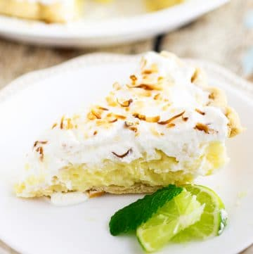 This old-fashioned Coconut Cream Pie recipe features creamy, silky homemade custard with sweet coconut flakes folded in a flaky pie crust topped with some fluffy homemade whipped cream and some toasted coconut flakes to make it pretty. I really love the flavors in this pie and it's cool, creamy filling make it a perfect spring dessert that we now serve as an Easter dessert every year!