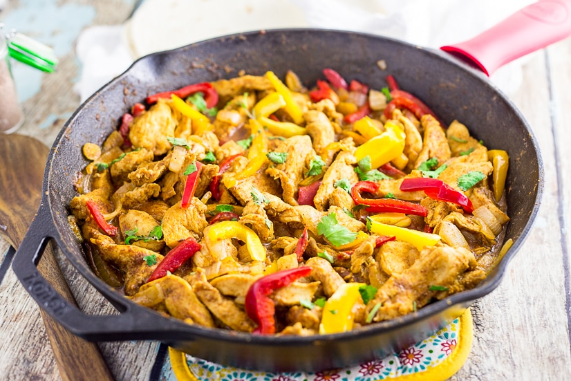 These Easy Chicken Fajitas are the perfect way to get a delicious and healthy dinner on the table in 30 minutes! A very simple marinade adds amazing flavor! These are the BEST chicken fajitas, and the marinade is seriously the best I've ever tried. Better than any restaurant!