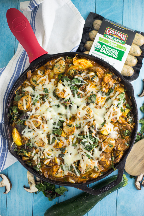 Zesty spinach chicken sausage and fresh veggies in a vibrant tomato sauce and covered in cheese in this Cheesy Chicken Sausage and Spinach Skillet Dinner recipe for an easy family dinner made in just one skillet in 30 minutes. This quick and easy sausage, veggie and rice skillet is downright delicious!