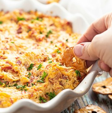 Make this easy Irish-inspired Reuben Dip recipe with creamy Thousand Island, tangy sauerkraut, salty corned beef, and gooey cheese in less than 30 minutes with just 5 ingredients! Great festive appetizer recipe for St Patrick's Day.