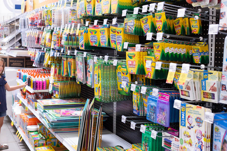 Rows of coloring supplies on store shelves