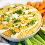 Best ever easy Crockpot Buffalo Chicken Dip is a creamy, cheesy crowd pleasing recipe with cool ranch and a spicy buffalo sauce kick. Tastes just like buffalo chicken wings, and will be the star of your party! Directions for cooking in the crock pot AND the oven! Plus video!