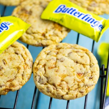 Chewy Butterfinger Cookies with crispy edges are packed with sticky, sweet Butterfinger pieces and chocolate and peanut butter flavor.