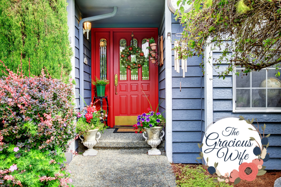 Blue house with garden and bright red door