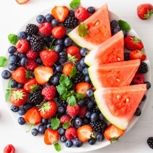 Watermelon and berries in a large bowl with mint